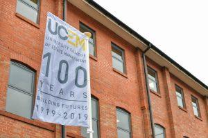 UCEM Centenary flag outisde of the UCEM office