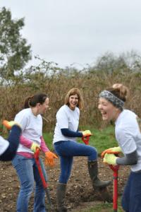 Staff having fun whilst digging