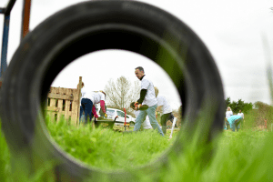 View of staff digging through a car tyre