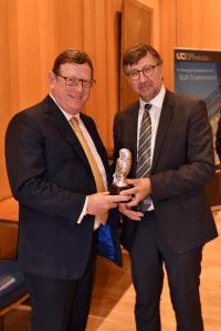 Sit James Waites receiving his award from John