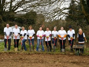 Volunteers ready with gardening forks