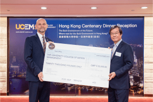 UCEM Principal, Ashley Wheaton, with alumnus, Dr Albert So and his cheque for £20,000 to go towards UCEM's centenary fund