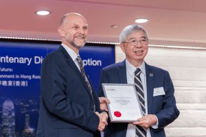 UCEM Principal, Ashley Wheaton, presents Professor Stephen Ho with his Honorary Fellow certificate at our Hong Kong centenary event