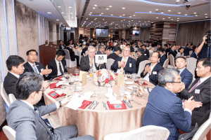Guests clapping at our Hong Kong centenary event