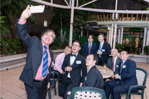 Guests taking a selfie at our Hong Kong centenary event