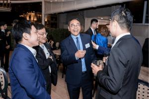 Guests enjoying a joke at our Hong Kong centenary event