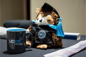 Oswald the Owl with a UCEM mug