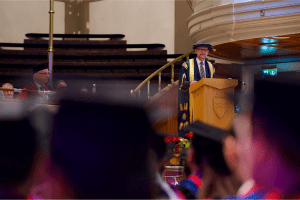 UCEM Principal, Ashley Wheaton, addressing graduands at the December 2019 Graduation