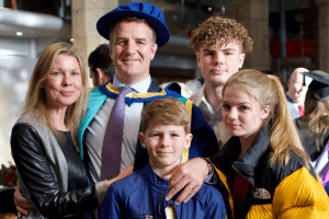 Honorary Degree recipient, Ciaran Bird, with his family