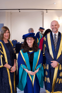 Honorary Doctorate recipient, Sherin Aminossehe, with UCEM Principal, Ashley Wheaton, and Deputy Principal, Jane Fawkes