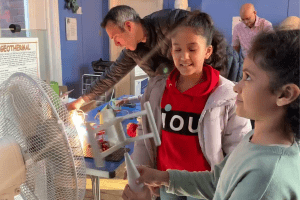 Kids try out the wind turbine