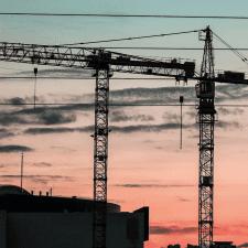 Cranes against skyline